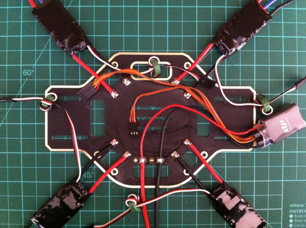 arms of the f450 frame and covered them with pvc heat shrink i soldered each esc the battery connector and the dji vu cable to the lower frame plate